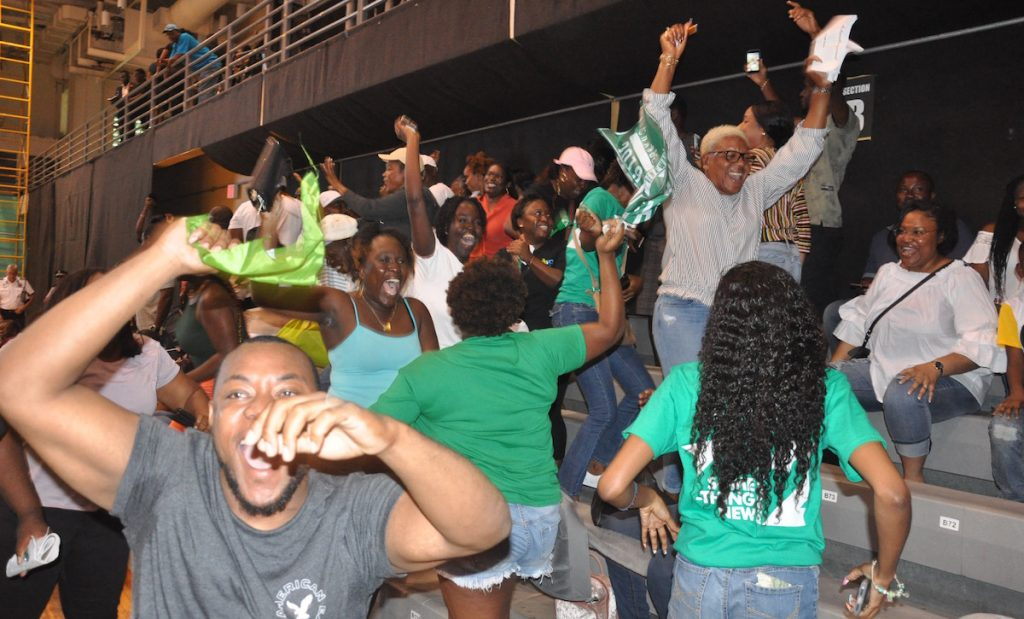 VIP supporters cheer.