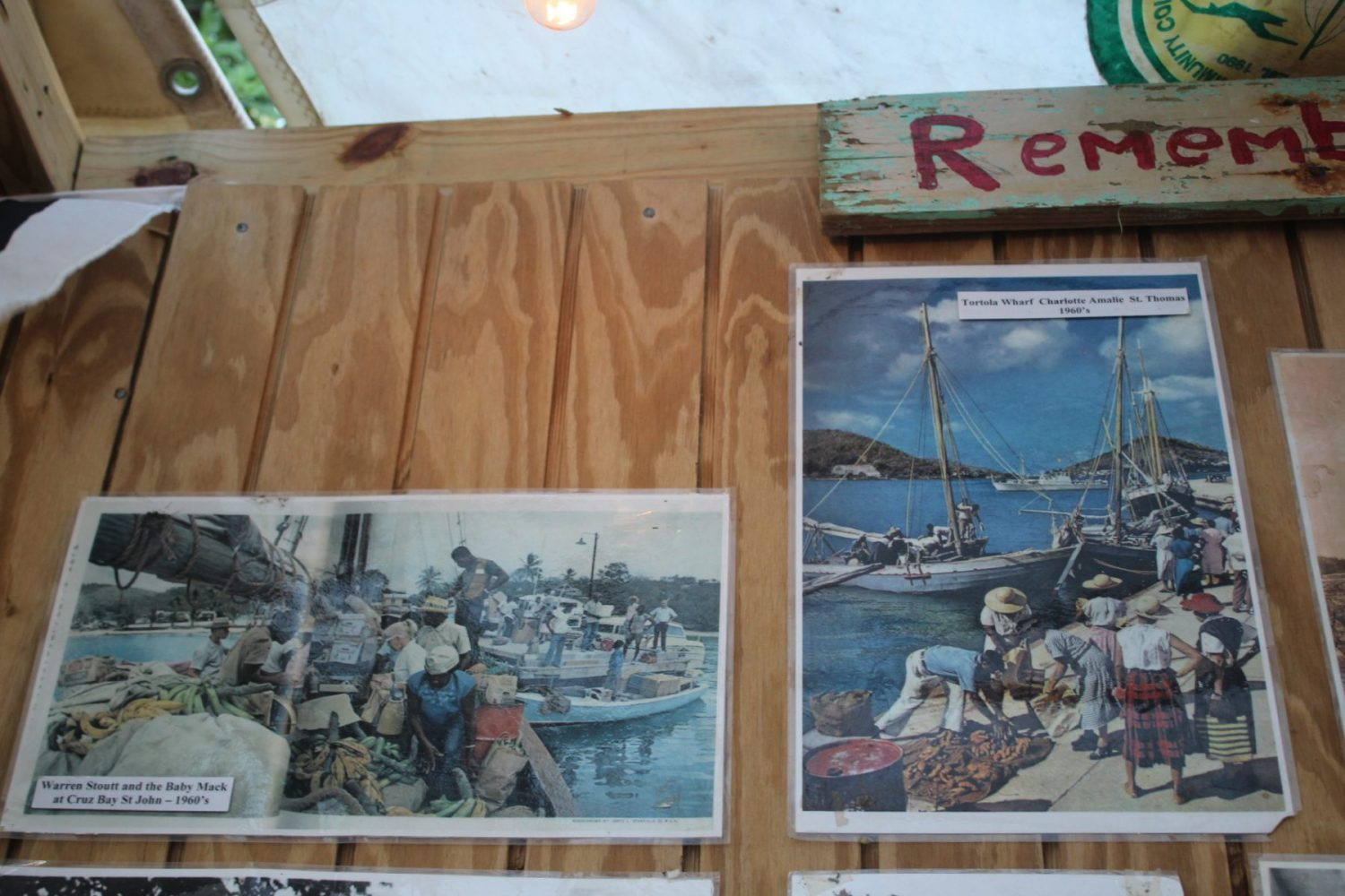 old photographs in a wooden boat workshop