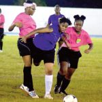 Sapphire Flax fights her way through two defenders during a match between Ballstars and VG United prior to the start of the women's league on Oct. 31. (Photo: BVIFA)